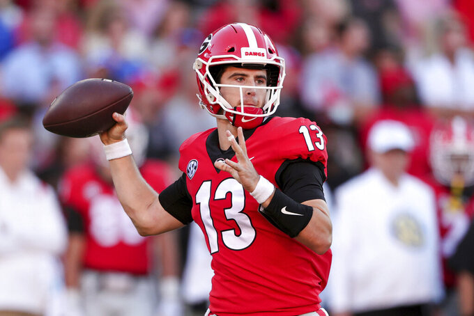 Georgia quarterback Stetson Bennett (13) throws a pass against Kentucky during the second half of an NCAA college football game Saturday, Oct. 16, 2021 in Athens, Ga. (AP Photo/Butch Dill)