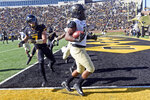 Vanderbilt tight end Jared Pinkney, right, runs into the end zone ahead of Missouri safety Cam Hilton after catching a 21-yard pass for a touchdown during the first half of an NCAA college football game Saturday, Nov. 10, 2018, in Columbia, Mo. (AP Photo/L.G. Patterson)