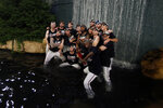 The Atlanta Braves celebrate in the in a fountain behind the center field wall after defeating the San Francisco Giants in a baseball game to clinch the NL East baseball title Friday, Sept. 20, 2019, in Atlanta. (AP Photo/John Bazemore)
