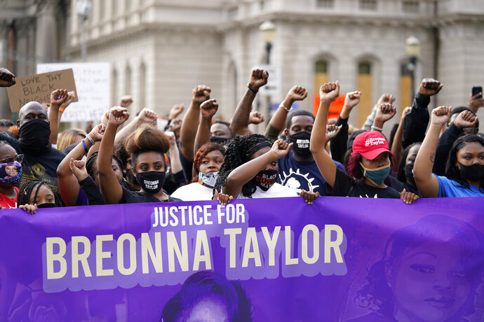 FILE - In this Sept. 25, 2020, file photo, Black Lives Matter protesters march in Louisville. Hours of material in the grand jury proceedings for Taylor's fatal shooting by police have been made public on Friday, Oct. 2. (AP Photo/Darron Cummings, File)