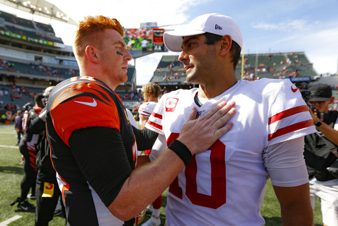 Cincinnati Bengals quarterback Andy Dalton, left, meets with San Francisco 49ers quarterback Jimmy Garoppolo, right, after an NFL football game Sunday, Sept. 15, 2019, in Cincinnati. (AP Photo/Frank Victores)