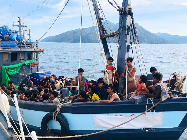 In this handout photo released on Sunday, April 5, 2020 by the Malaysian Maritime Enforcement Agency, a wooden boat carries suspected Rohingya migrants detained in Malaysian territorial waters off the island of Langkawi, Malaysia. Malaysian authorities said they have arrested a boatload of 202 people believed to be minority Muslim Rohingya refugees after their boat was found adrift Sunday morning near the northern resort island of Langkawi. (Malaysian Maritime Enforcement Agency via AP)