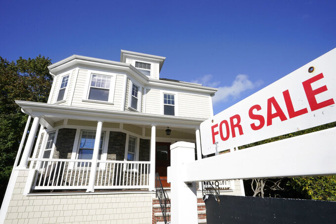 FILE - A for sale sign stands in front of a house, Tuesday, Oct. 6, 2020, in Westwood, Mass.   The long period of ultra-low rates on home loans may be over. Long-term bond yields, which can influence interest rates on mortgages, have climbed this month amid expectations of ramped-up U.S. government stimulus spending, economic growth and higher inflation.  (AP Photo/Steven Senne, File)