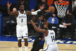 New York Knicks center Nerlens Noel (3) looks to pass the ball while defended by Brooklyn Nets forwards Jeff Green (8) and Reggie Perry (14) during the third quarter of an NBA basketball game Wednesday, Jan. 13, 2021, in New York. (Brad Penner/Pool Photo via AP)
