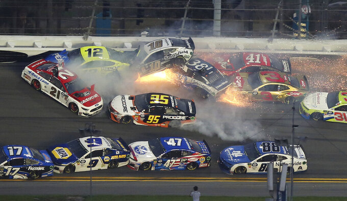 Multiple cars crash during a NASCAR Daytona 500 auto race Sunday, Feb. 17, 2019, at Daytona International Speedway in Daytona Beach, Fla. (AP Photo/Jim Topper)