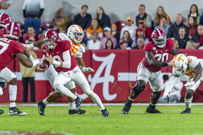 Alabama quarterback Mac Jones (10) carries the ball against Tennessee during the second half of an NCAA college football game Saturday, Oct. 19, 2019, in Tuscaloosa, Ala. (AP Photo/Vasha Hunt)