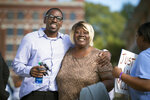 FILE - In this Oct. 13, 2017, file photo, Lamonte McIntyre, left, who was imprisoned for 23 years for a 1994 double murder in Kansas that he always said he didn't commit, walks out of a courthouse in Kansas City, Kan., with his mother, Rosie McIntyre, after Wyandotte County District Attorney Mark A. Dupree, Sr. dropped the charges. Kansas is fighting McIntyre's compensation claim for the years spent behind bars before a court vacated his convictions. McIntyre's case was one of three that helped prompt the state last year to allow the wrongfully convicted to seek compensation from it. (Tammy Ljungblad /The Kansas City Star via AP, File)