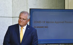 Australia's Prime Minister Scott Morrison speaks at a press conference at Parliament House in Canberra, Monday, Jan. 25, 2021. Australia's medical regulator has approved use of its first coronavirus vaccine, paving the way for inoculations to begin next month. (Mick Tsikas/AAP Image via AP)