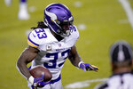 Minnesota Vikings running back Dalvin Cook gains yardage after catching a pass during the first half of an NFL football game against the Chicago Bears Monday, Nov. 16, 2020, in Chicago. (AP Photo/Charles Rex Arbogast)