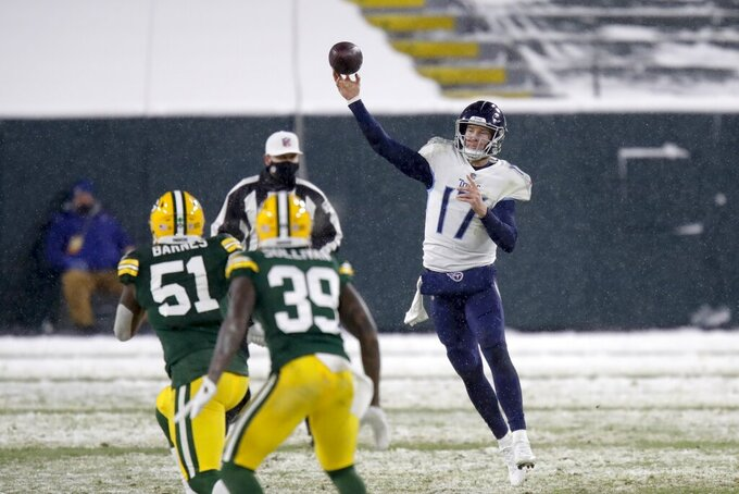 Tennessee Titans' Ryan Tannehill throws a pass during the second half of an NFL football game against the Green Bay Packers Sunday, Dec. 27, 2020, in Green Bay, Wis. (AP Photo/Matt Ludtke)