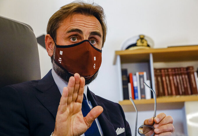 Lawyer Roberto De Vita, representing WHO's deputy director General Ranieri Guerra, speaks during an interview with The Associated Press at his law firm in Rome, Monday, May 10, 2021. A top World Health Organization official has strongly denied making false statements to Italian prosecutors about a spiked U.N. report into Italy's coronavirus response, doubling down on his assertions in court documents obtained by The Associated Press. Dr. Ranieri Guerra, a WHO special adviser, outlined his position in a 40-page response, with a 495-page annex, to prosecutors who placed him under investigation last month for having allegedly made false statements to them when he voluntarily went to be questioned Nov. 5. (AP Photo/Domenico Stinellis)