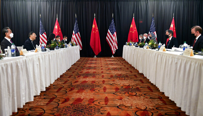 Secretary of State Antony Blinken, second from right, joined by national security adviser Jake Sullivan, right, speaks while facing Chinese Communist Party foreign affairs chief Yang Jiechi, second from left, and China's State Councilor Wang Yi, left, at the opening session of US-China talks at the Captain Cook Hotel in Anchorage, Alaska, Thursday, March 18, 2021. (Frederic J. Brown/Pool via AP)