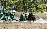 Shinto priests offer rice and sake during a ground-breaking ceremony at the Imperial Palace in Tokyo Friday, July 26, 2019. The ceremony was held in the compound of the palace to pray for safe and successful construction of a pair of shrines for Emperor Naruhito's key succession rituals later this year. (Kyodo News via AP)
