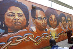 """Five of the six civil rights legends, living and dead, that the Jackson State University's Office of Community Engagement, are honored with the unveiling of its """"Chain Breakers"""" mural at the COFO building in Jackson, Miss., Saturday, July 24, 2021. From left they are, civil rights leader Fannie Lou Hamer; educator and civil rights activist, Bob Moses; higher education educator Rose Elizabeth Howard Robinson; the first African American bookstore owner in the Washington Addition community Louise Marshall, and the first African American florist in the Washington Addition, Albert Powell. (AP Photo/Rogelio V. Solis)"""