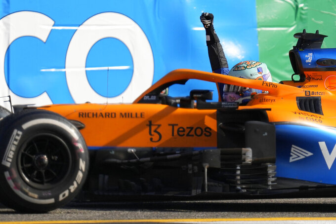 Mclaren driver Daniel Ricciardo of Australia celebrates after winning the Italian Formula One Grand Prix, at Monza racetrack, in Monza, Italy, Sunday, Sept.12, 2021. (AP Photo/Antonio Calanni)
