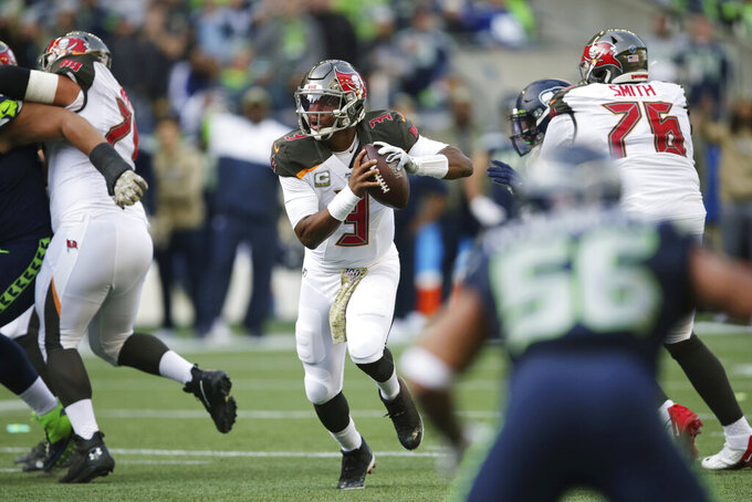 Tampa Bay Buccaneers quarterback Jameis Winston scrambles before passing to wide receiver Mike Evans for a touchdown during the first half of an NFL football game against the Seattle Seahawks, Sunday, Nov. 3, 2019, in Seattle. (AP Photo/Scott Eklund)