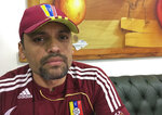 """This Nov. 8, 2019 photo shows Lt. Col. Illich Sanchez, part of a group of Venezuela troops holed up for seven months in a foreign embassy after revolting against President Nicolas Maduro in an April uprising, sitting inside Panama's Embassy in Caracas, Venezuela. """"When I gathered my troops at 2 a.m. and told them we were going to liberate Venezuela they broke down in tears,"""" said Sanchez, who commanded a garrison of some 500 guardsmen charged with providing security at the presidential palace, congress and supreme court. """"Nobody saw it coming, but they were all immediately committed."""" (AP Photo)"""