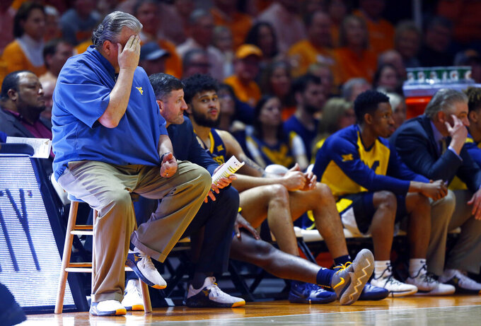 West Virginia head coach Bob Huggins reacts to play in the second half of an NCAA college basketball game against Tennessee, Saturday, Jan. 26, 2019, in Knoxville, Tenn. Tennessee won 83-66. (AP Photo/Wade Payne)