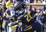 Vanderbilt wide receiver Chris Pierce (19) is hit by Missouri defensive back Khalil Oliver (20) after catching a pass during the first half of an NCAA college football game Saturday, Nov. 10, 2018, in Columbia, Mo. (AP Photo/L.G. Patterson)