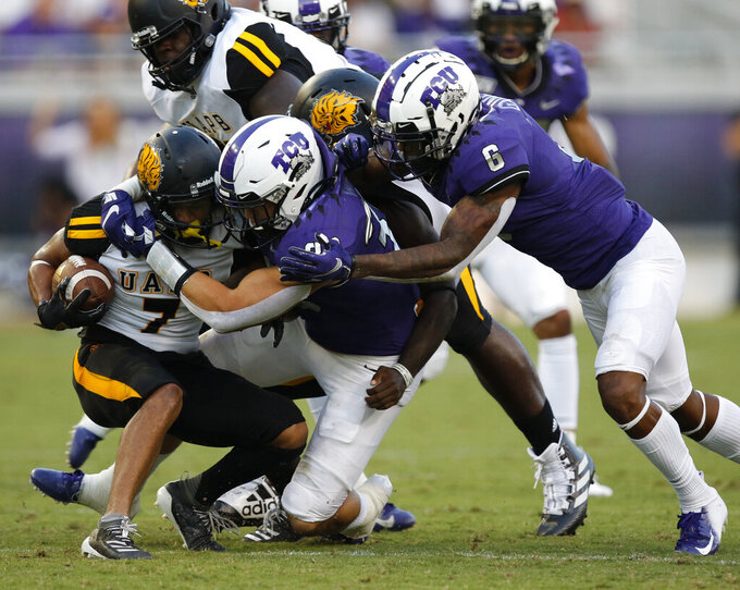 TCU's Garrett Wallow (30) and Innis Gaines (6) tackle UAPB's Tyrin Ralph during the first half of an NCAA college football game Saturday, Aug. 31, 2019, in Fort Worth, Texas. (David Kent/Star-Telegram via AP)
