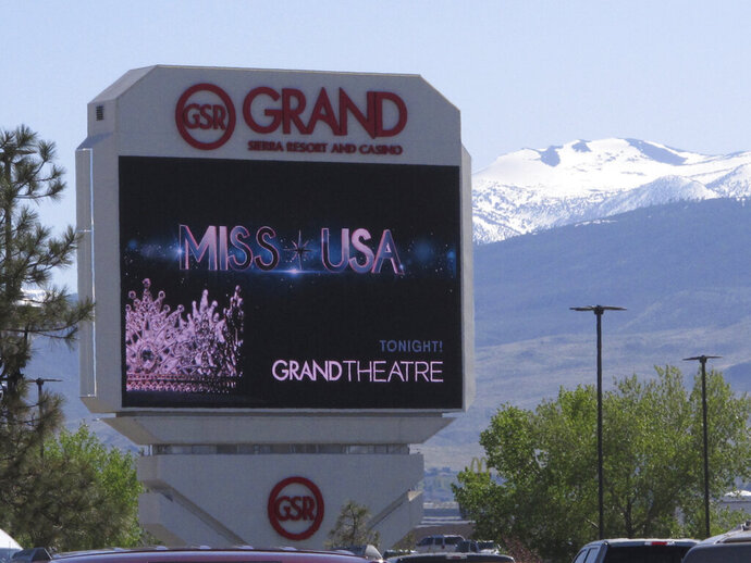 The marquee promotes the Miss USA pageant an hour before it began Thursday, May 2, 2019 at the Grand Sierra hotel-casino in Reno, Nevada. It's the first time the northern Nevada city on the edge of the Sierra has hosted the event that dates to 1952. This year's contestants included a psychological operations expert in the Army reserves, an ex-NFL cheerleader working to become a surgical nurse and a lawyer who represents some prisoners for free. (AP Photo/Scott Sonner)