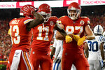 Kansas City Chiefs wide receiver Byron Pringle (13) celebrates his touchdown against the Indianapolis Colts with wide receiver Demarcus Robinson (11) and tight end Travis Kelce (87) during the first half of an NFL football game in Kansas City, Mo., Sunday, Oct. 6, 2019. (AP Photo/Ed Zurga)