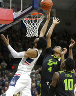 Connecticut's Tyler Polley, left, drives to the basket past South Florida's Michael Durr (4) and Alexis Yetna (10) during the second half of an NCAA college basketball game, Sunday, March 3, 2019, in Storrs, Conn. (AP Photo/Steven Senne)