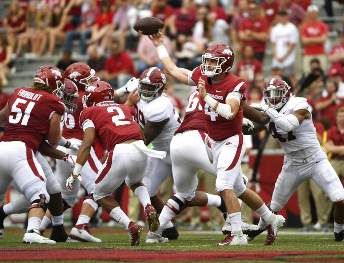 Arkansas quarterback Ty Storey throws a pass against Alabama in the first half of an NCAA college football game Saturday, Oct. 6, 2018, in Fayetteville, Ark. (AP Photo/Michael Woods)