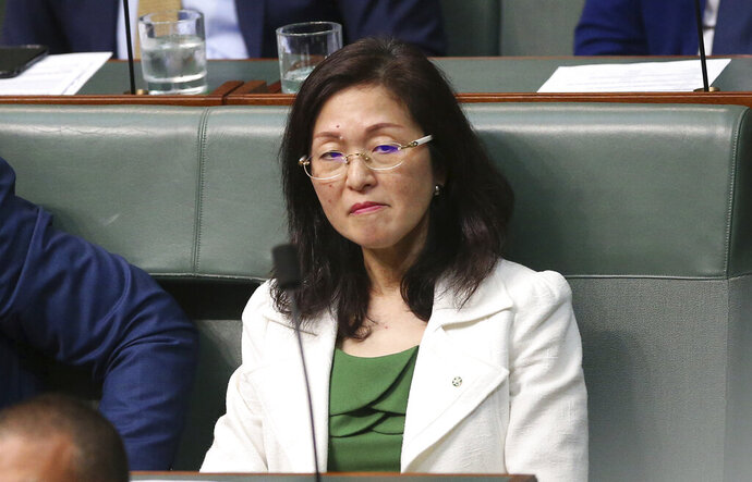 Gladys Liu, the first Chinese-born lawmaker to be elected to Australia's Parliament, sits silently in the House of Representatives in Canberra, Australia, on Wednesday, Sept. 11, 2019. Liu has come under attack over her links to the Chinese foreign influence network. (AP Photo/Rod McGuirk)