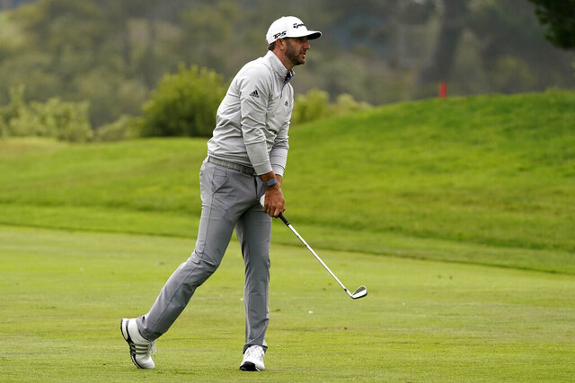 Dustin Johnson hits from the fairway on the 18th hole during the third round of the PGA Championship golf tournament at TPC Harding Park Saturday, Aug. 8, 2020, in San Francisco. (AP Photo/Charlie Riedel)