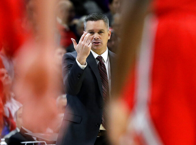 Ohio State coach Chris Holtmann calls his team during the first half of an NCAA college basketball game against Northwestern, Wednesday, March 6, 2019, in Evanston, Ill. (AP Photo/Nam Y. Huh)
