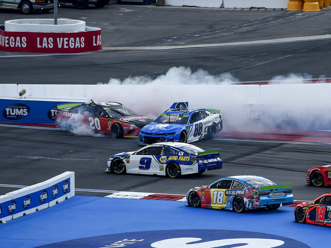 Erik Jones (20) and Alex Bowman (88) spin during the NASCAR Cup Series auto race at Charlotte Motor Speedway Sunday, Sept. 29, 2019 in Concord, N.C. (AP Photo/Mike McCarn)