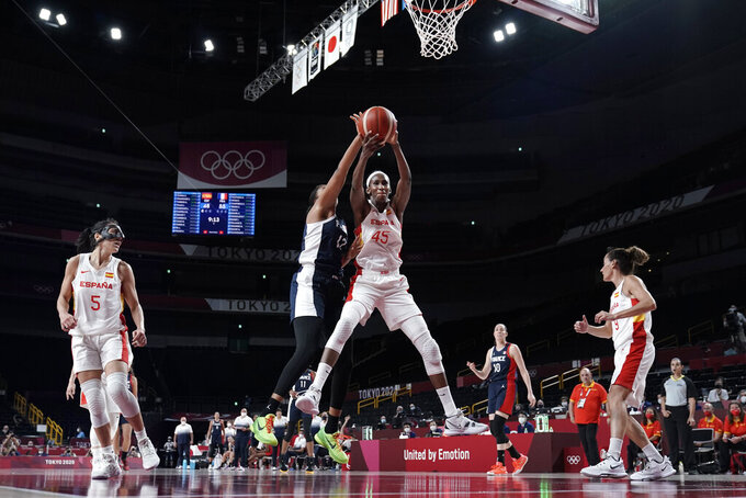 Spain's Astou Ndour (45) grabs a rebound in front of France's Iliana Rupert (12) during a women's basketball quarterfinal round game at the 2020 Summer Olympics, Wednesday, Aug. 4, 2021, in Saitama, Japan. (AP Photo/Eric Gay)
