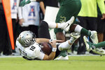Central Florida  quarterback McKenzie Milton goes down with an apparent knee injury after being tackled during the first half of an NCAA college football game against South Florida Friday, Nov. 23, 2018, in Tampa, Fla. (AP Photo/Mike Carlson)