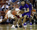 Texas guard Matt Coleman III, left, drives around TCU guard Alex Robinson (25) during the first half of an NCAA college basketball game, Saturday, March 9, 2019, in Austin, Texas. (AP Photo/Eric Gay)