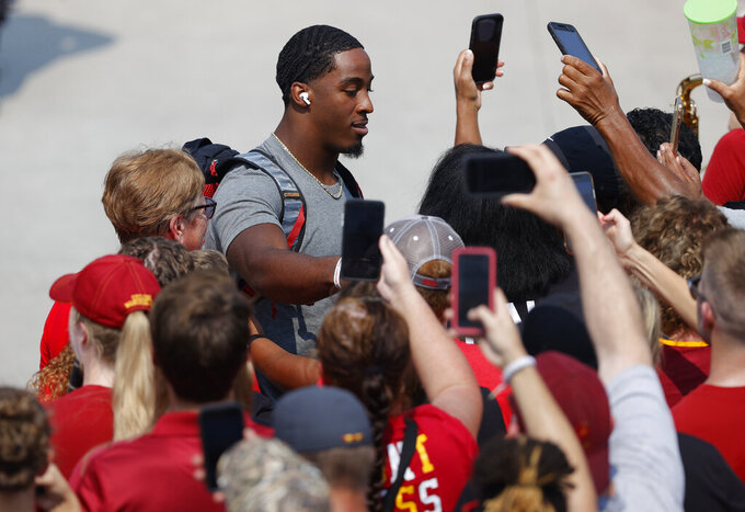 Iowa State running back Breece Hall (28) greets fans along the spirit walk before an NCAA college football game against Iowa, Saturday, Sept. 11, 2021, in Ames, Iowa. (AP Photo/Matthew Putney)