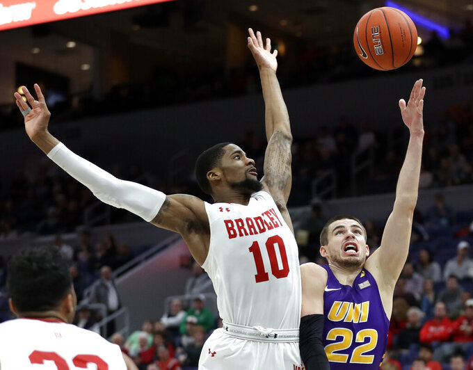 Northern Iowa's Wyatt Lohaus (22) shoots as Bradley's Elijah Childs (10) defends during the first half of an NCAA college basketball game in the championship of the Missouri Valley Conference tournament, Sunday, March 10, 2019, in St. Louis. (AP Photo/Jeff Roberson)