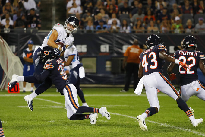 Tennessee Titans wide receiver Cody Hollister (16) is tackled by Chicago Bears cornerback Michael Joseph (30) during the second half of an NFL preseason football game Thursday, Aug. 29, 2019, in Chicago. (AP Photo/Charles Rex Arbogast)