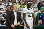 Michigan State head coach Tom Izzo and forward Gabe Brown (44) react after a dunk by forward Julius Marble during the second half of an NCAA college basketball game against Northwestern, Wednesday, Jan. 29, 2020, in East Lansing, Mich. (AP Photo/Carlos Osorio)