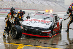 Noah Gragson's pit crew work on his damaged car during a yellow flag pit stop during a NASCAR Xfinity Series auto race at Charlotte Motor Speedway in Concord, N.C., Saturday, Oct. 10, 2020. (AP Photo/Nell Redmond)