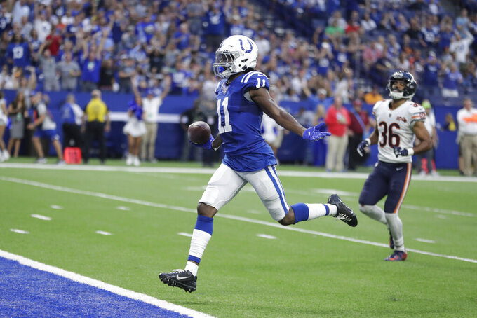 Indianapolis Colts wide receiver Deon Cain (11) celebrates as he runs into the end zone with a touchdown reception during the first half of the team's NFL preseason football game against the Chicago Bears, Saturday, Aug. 24, 2019, in Indianapolis. (AP Photo/Michael Conroy)