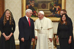 """Pope Francis shares a word with US Vice President Mike Pence, second from left, his wife Karen, right, and his daughter in law Sarah on the occasion of their private audience, at the Vatican, Friday, Jan. 24, 2020. Pence told Pope Francis, """"You made me a hero"""
