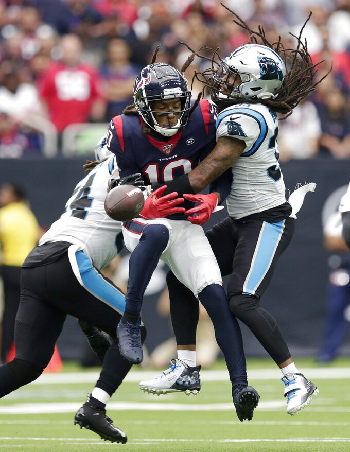Carolina Panthers defensive back Tre Boston (33) breaks up a pass intended for Houston Texans wide receiver DeAndre Hopkins (10) during the first half of an NFL football game Sunday, Sept. 29, 2019, in Houston. (AP Photo/Michael Wyke)