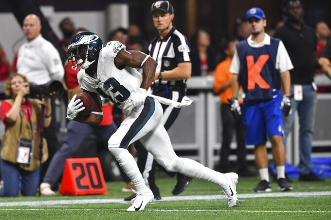 Philadelphia Eagles wide receiver Nelson Agholor (13) runs after a catch against the Atlanta Falcons during the first half of an NFL football game, Sunday, Sept. 15, 2019, in Atlanta. (AP Photo/John Amis)