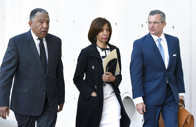 Former Baltimore mayor Catherine Pugh, center, and her attorney Steven Silverman, right, arrive for a sentencing hearing at U.S. District Court in Baltimore on Thursday, Feb. 27, 2020. Pugh pleaded guilty in 2019 to federal conspiracy and tax evasion charges. (AP Photo/Steve Ruark)