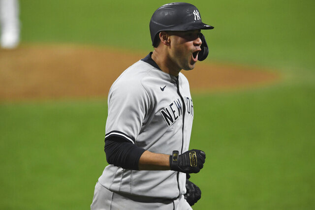 New York Yankees' Gary Sanchez reacts after hitting a two-run home run off Cleveland Indians relief pitcher Triston McKenzie durng the sixth inning of Game 2 of an American League wild-card baseball series, Wednesday, Sept. 30, 2020, in Cleveland. (AP Photo/David Dermer)