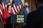 Sen. Mazie Hirono, D-Hawaii, accompanied by Senate Majority Leader Chuck Schumer, D-N.Y., speaks during a news conference on Capitol Hill, in Washington, Tuesday, April 13, 2021. (AP Photo/Jose Luis Magana)
