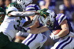 Baylor safety Chris Miller, left, tackles Kansas State running back Harry Trotter, right, during the first half of an NCAA college football game in Manhattan, Kan., Saturday, Oct. 5, 2019. (AP Photo/Orlin Wagner)
