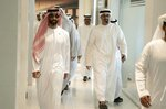 In this Feb. 6, 2019 photo, released by Emirates News Agency, WAM, Sheikh Tahnoun bin Zayed Al Nahyan, left, walks to a meeting in Abu Dhabi, United Arab Emirates. Corporate records and a computer researcher say individuals linked to Sheikh Tahnoun are tied to the video and voice calling app ToTok, which is suspected of being a spying tool of the United Arab Emirates. The app's co-founder, Giacomo Ziani, defended his work in an interview with The Associated Press, while denying knowing that people and companies linked to the project had ties to the country's intelligence apparatus. (WAM via AP)
