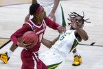 Baylor guard Davion Mitchell, right, is fouled by Arkansas guard Jalen Tate (11) 1during the second half of an Elite 8 game in the NCAA men's college basketball tournament at Lucas Oil Stadium, Monday, March 29, 2021, in Indianapolis. (AP Photo/Darron Cummings)